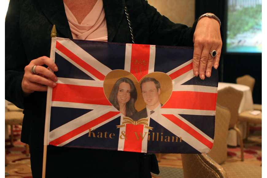 Suzanne Willis shows off the custom British flag she ordered from England and the knock-off royal wedding ring she bought at Michael's two days before the big event. Willis was the main organizer behind the Ritz Carlton event.