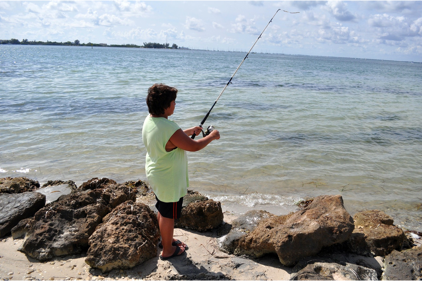 Edgar Morales, 11, fishes at Bird Key Park while on vacation with his family.