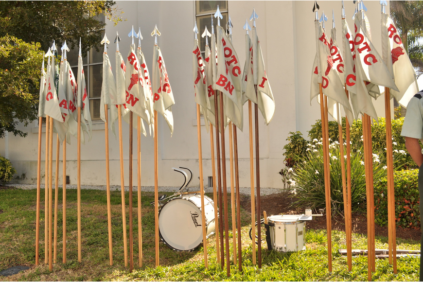 As they rounded the corner of the church, students dropped off their flagpoles and drums.