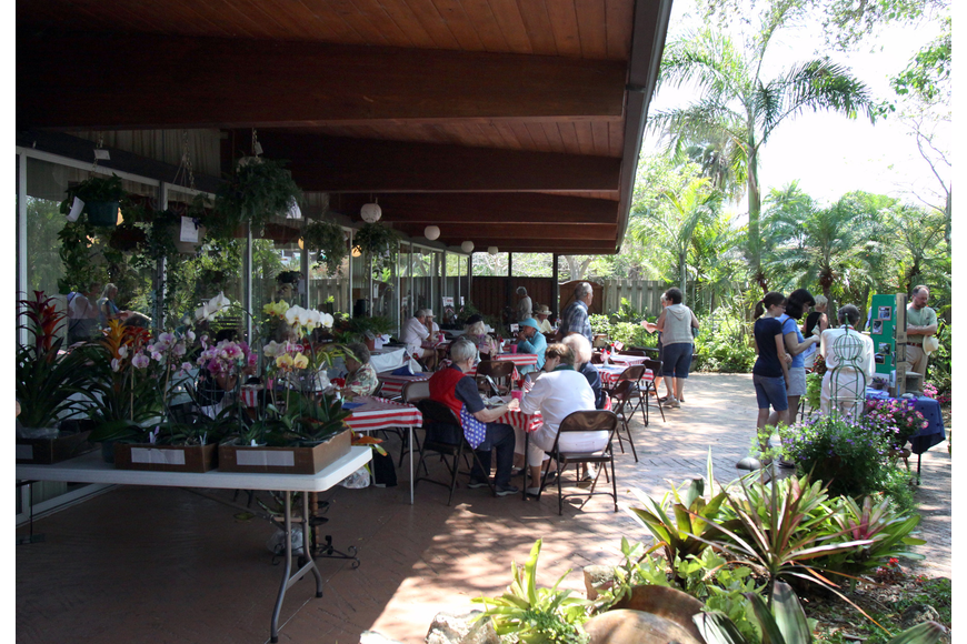 People enjoy eating lunch outside in the garden on Sunday, March 27 during the 74th Annual Sarasota Garden Club Flower Show.