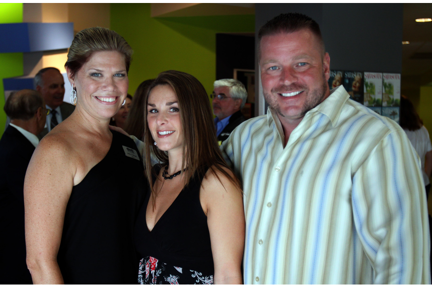 Molly Morgan, CEO of G. WIZ, poses with Wendy and Shawn Crane at the opening of the G. WIZ Faulhaber Fab Lab Thursday, May 5 at G. WIZ.