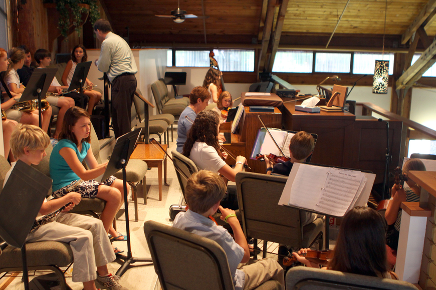 The Lower School Orchestra warms up Friday, June 3 prior to the beginning of ODA's 6th grade graduation at Siesta Key Chapel.