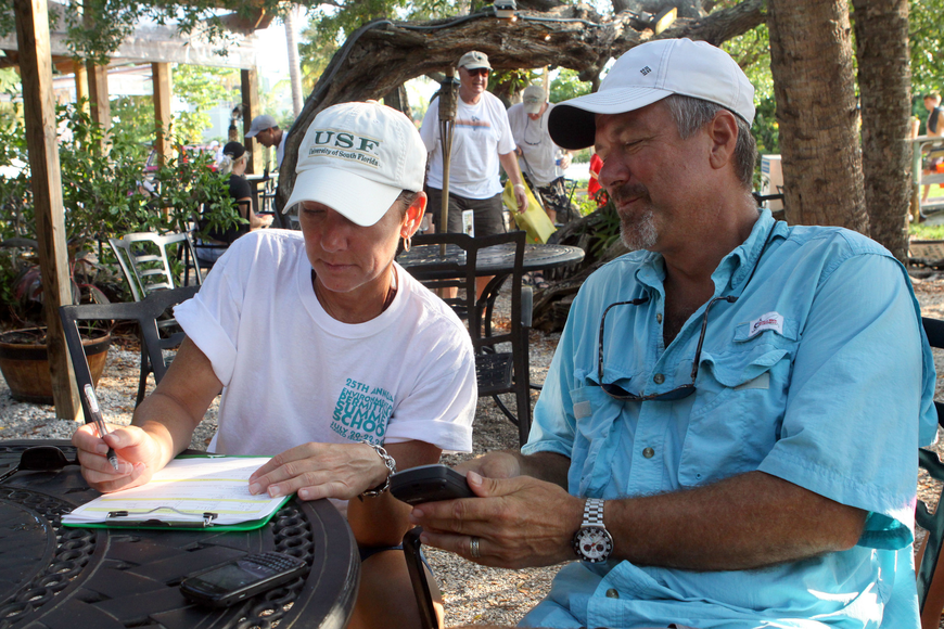 Alison Albee and Tim Thurman look at their assigned area and their handheld GPS to figure out where they would be heading out Saturday, August 13 during the 4th Annual Sarasota Bay Great Scallop Search.