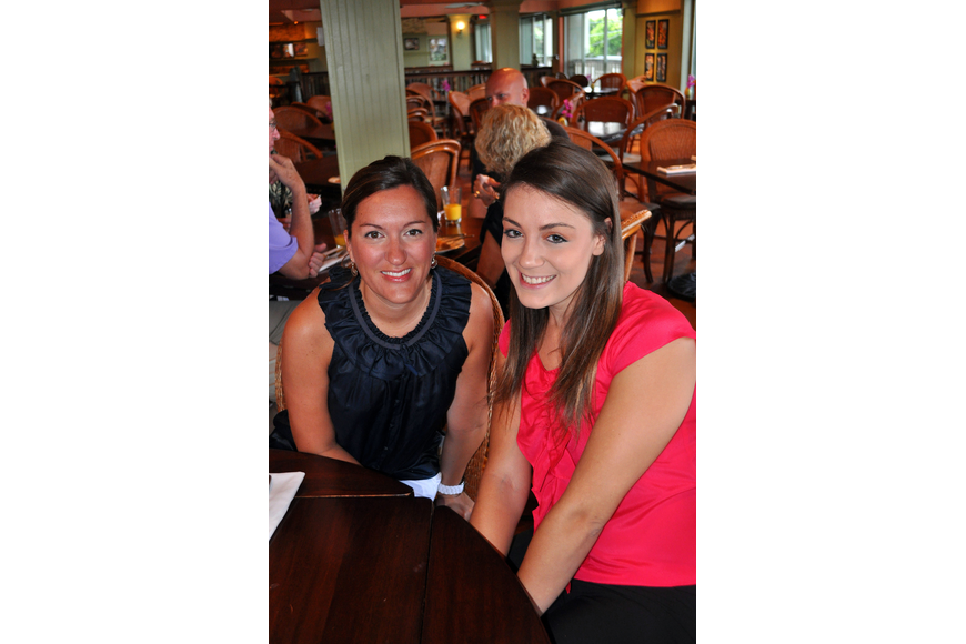 Stacy Alexander and Amanda Rondosh pose together Tuesday, Aug., 16 at Tommy Bahama Restaurant.