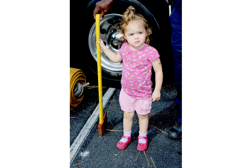 Firefighter-in-training Avrey Carver is ready to break some doors in with the truck's axe.