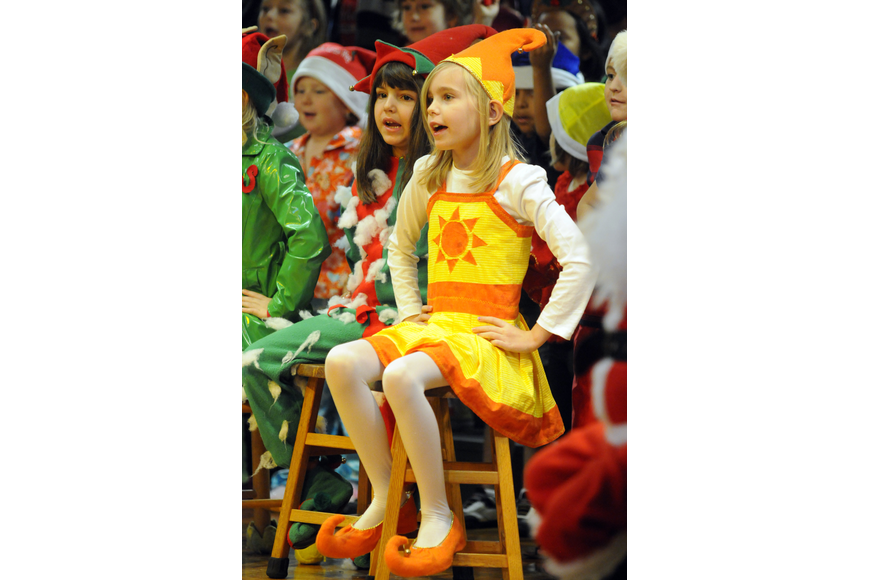 Windy elf, Victoria Kelley, left, and sunny elf, Iris Taverney, enjoyed performing in this year's Christmas musical.