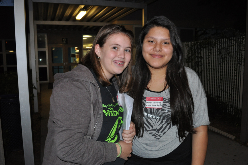 Jenny Kleer and Brenda Sanchez, of the National Junior Honor Society, passed out informational packets to guests.