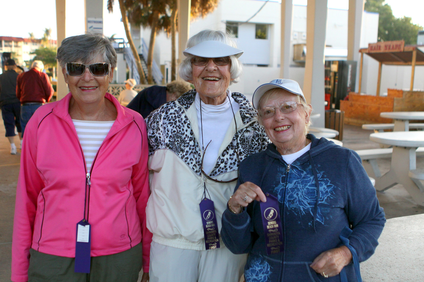 Joan Bloom, Leni Markell and Marcia Horn pose inside the pavilion before heading off towards the beach for the Senior Beach Walk, Wednesday, Feb. 1.
