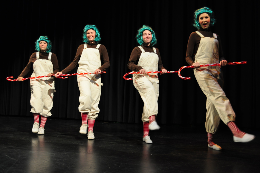Oompaloompas sing and dance about chocolate.