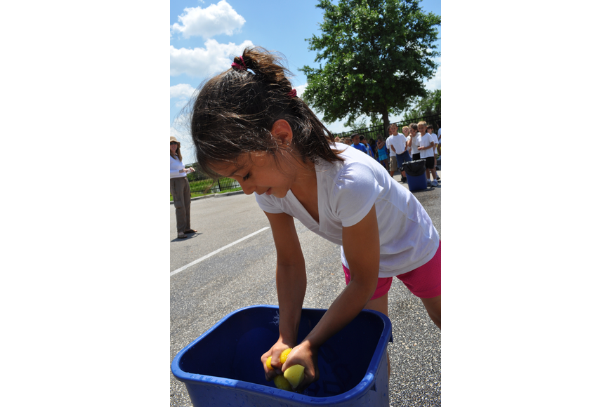First-grader Jenna Holmes participated in a wet sponge squeeze race.