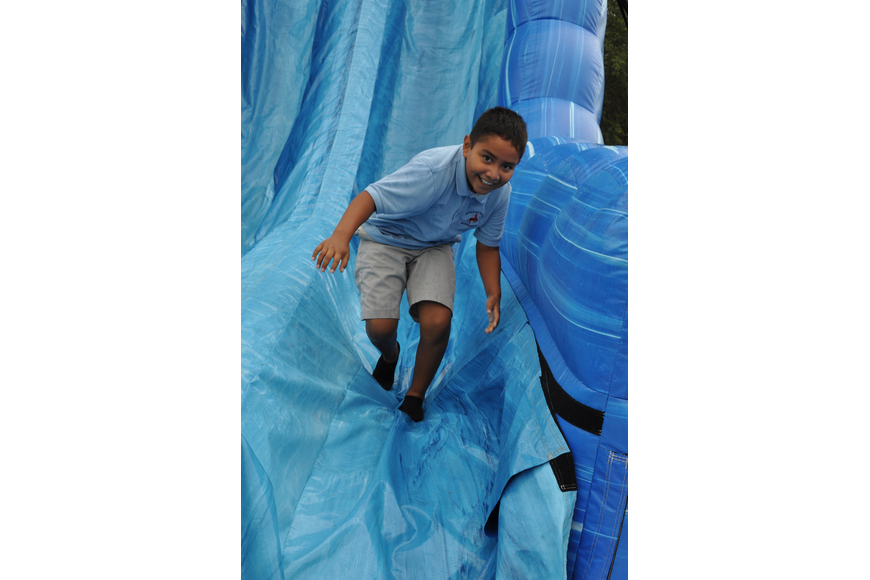Jose Villa enjoyed the steep slope of the inflatable slide.