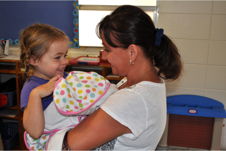 Avery Carver, 4, jumped into the arms of her former teacher, Natlaiya Fesko, Monday, Aug. 20, at St. Boniface Preschool.