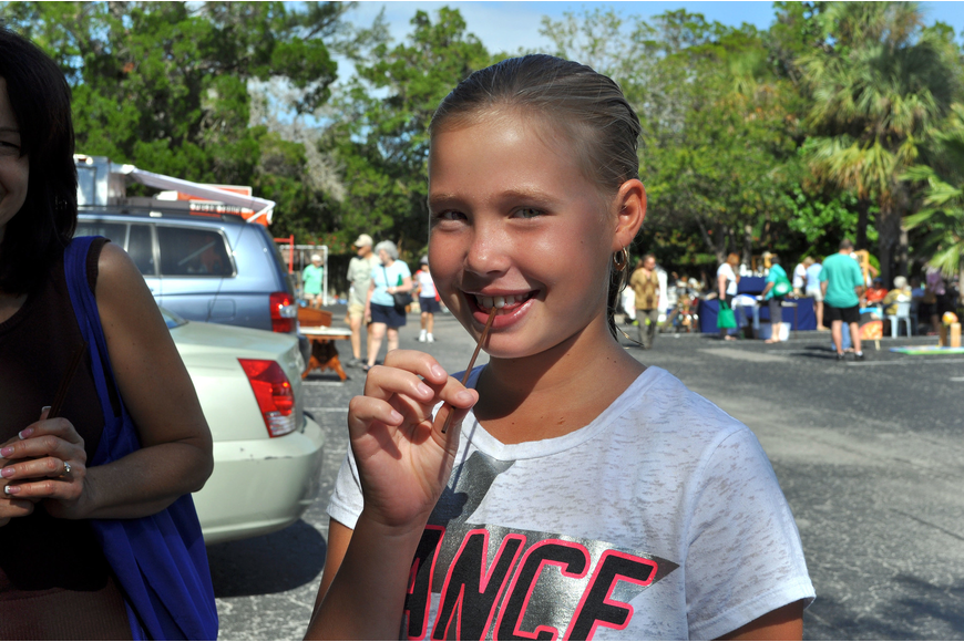 Micah Barnes, 10, tries key lime honey from the Winter Park Honey tent.