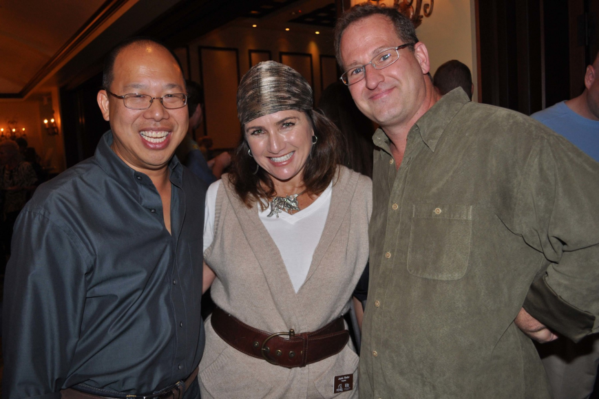 Filic Chung and Chip Nemec, with Polo Grill and Bar owner Jaymie Klauber, center.