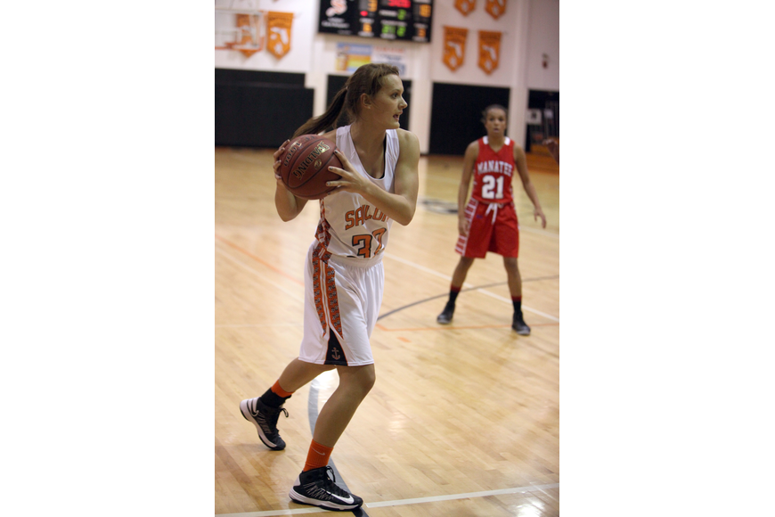 Brooke Blackwell, No. 32, looks around to pass the ball to one of her teammates.