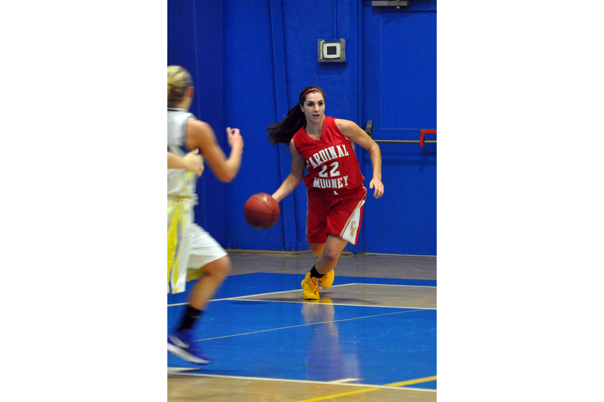 Cardinal Mooney's Camille Giardina, No. 22, takes possession of the ball and begins to dribble it back down the court.