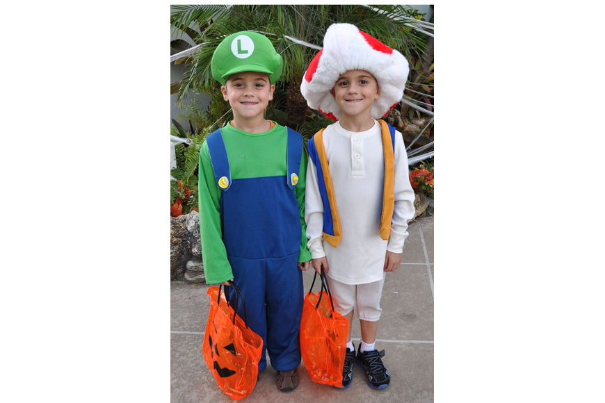 Paul and Anthony Metivier, dressed as Super Mario characters, were among the thousands who participated in the third annual Fright Night Oct. 31 at St. Armand's Circle.