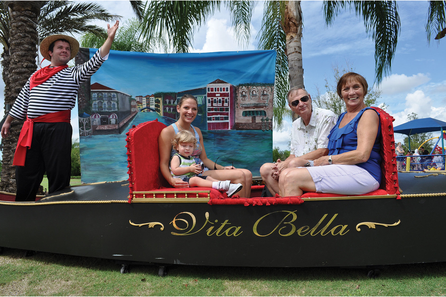 Robin Quinten and her son, Mason, get a family picture with Robin's parents, Robin and Rosalie Jones, during Festa Italia Oct.6. Published Oct. 11, 2012.