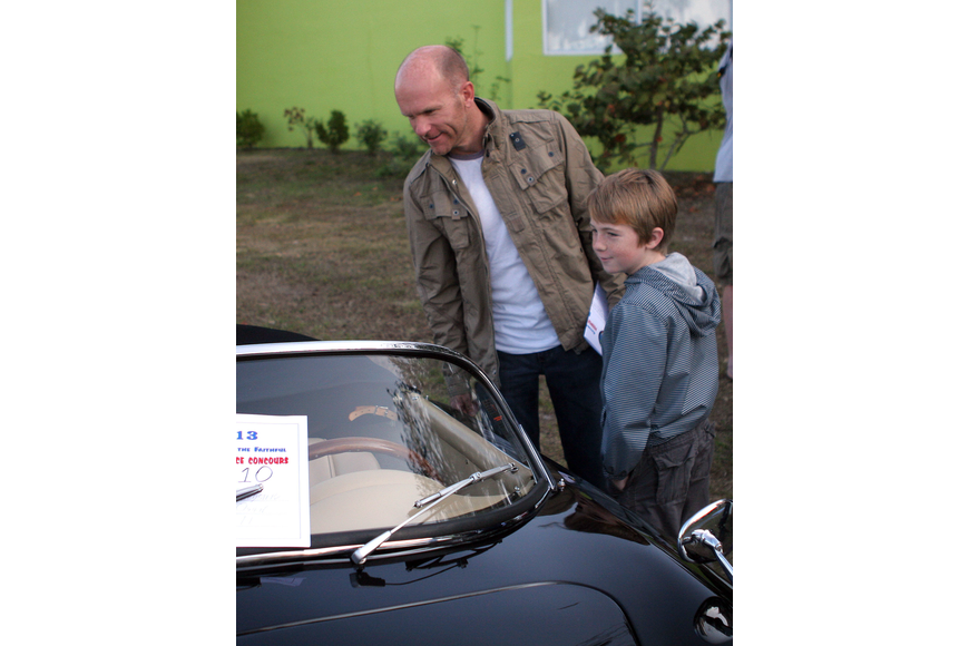Toby Delbridge and his son Cooper, 9, have fun looking at all the Porsches, especially the speedsters.