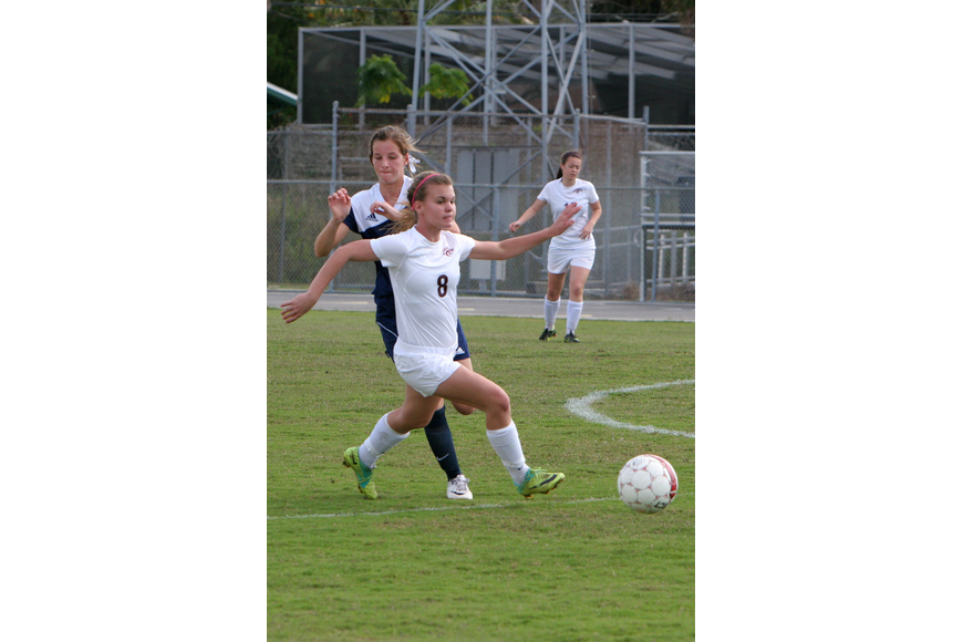 North Port's Hunter Carrell, No. 10, chases after Riverview's Ansley Saba, No. 8, Saturday, Jan. 12, at Riverview High School.