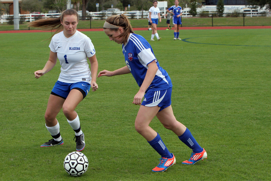 Sarasota Christian's Cece Gensen, No. 1, and Northside Christian's Rhea Gilbert, No. 6, fight over the ball.