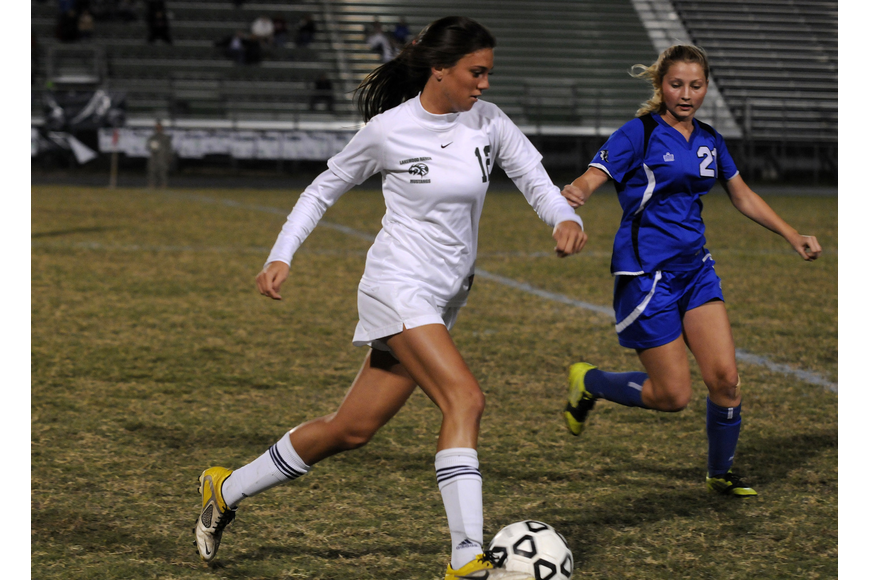 Lakewood Ranch senior Chelsea Martin pushes the ball up the field in first half.