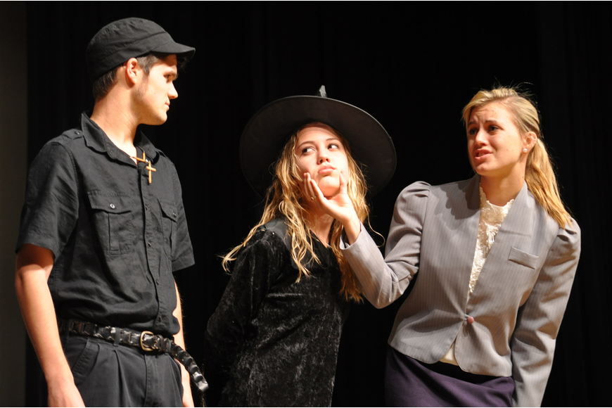 Michael Vanderford, playing Jack the bailiff, watched as MaKenna Chandler, the Wicked Witch, got scolded by Kayla Lindsay, the defense attorney.