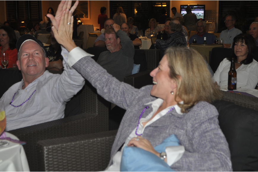 Mary and Steve Wiltse high-five after a Baltimore touchdown during the second quarter