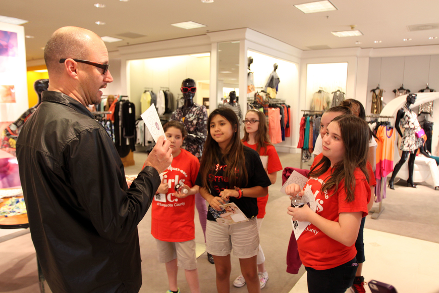 Robert Roubideaux, visual manager, talks to the girls about the displays he puts together at Saks Fifth Avenue at the Westfield Southgate Mall.