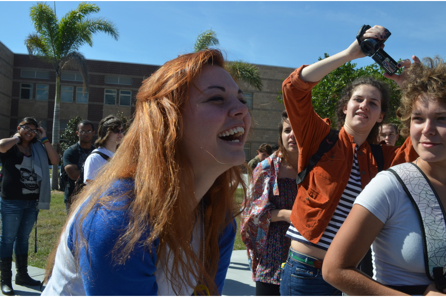 Sophomore Megan Adams finds out she won a 2002 Saturn SL that was donated by a family in the school.