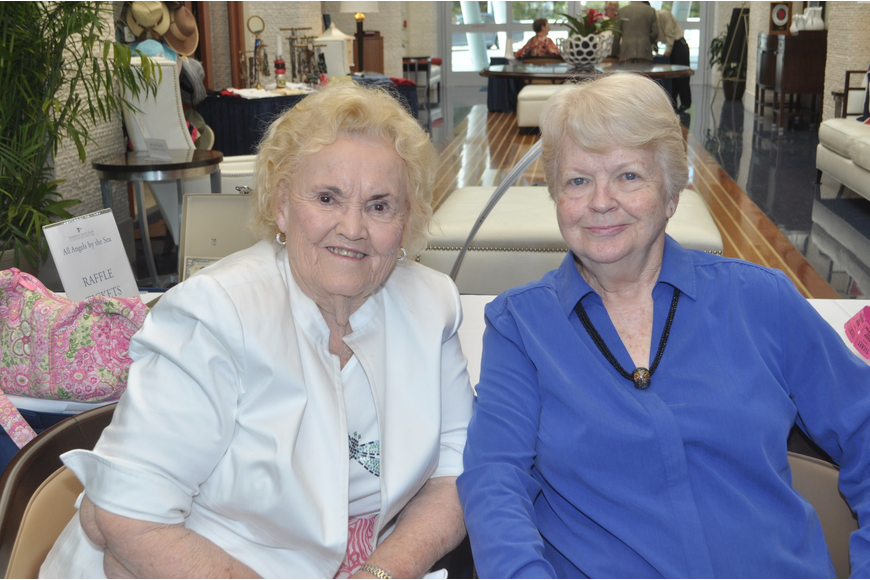 Beverly Sinclair and Carolyn Judd sell raffle tickets