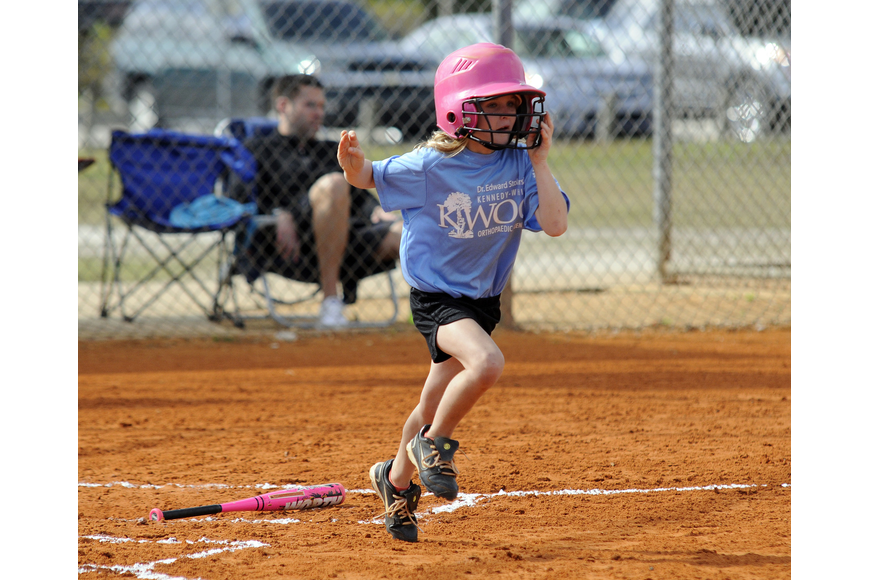 Six-year-old Nikki Koukouvas races to first base after hitting a single.