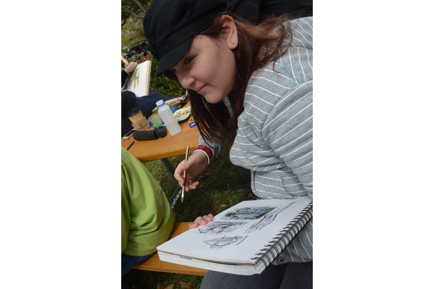 Booker High School freshmen Franchesca Alvarado is part of the Visual and Performing Arts art class and came to the art festival to draw.