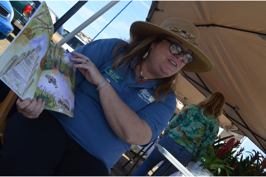 Author Amy Elder reads her children's book Portal to Florida's Past to kids.