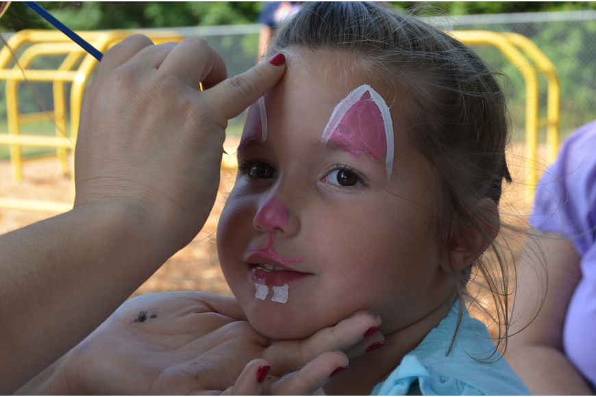 Aiva Rispoli gets her face painted.