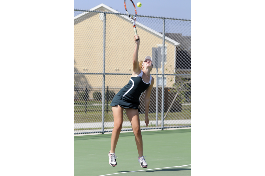 Lakewood Ranch's Casey Rowe serves the ball during her No. 2 doubles semifinal versus Sarasota.