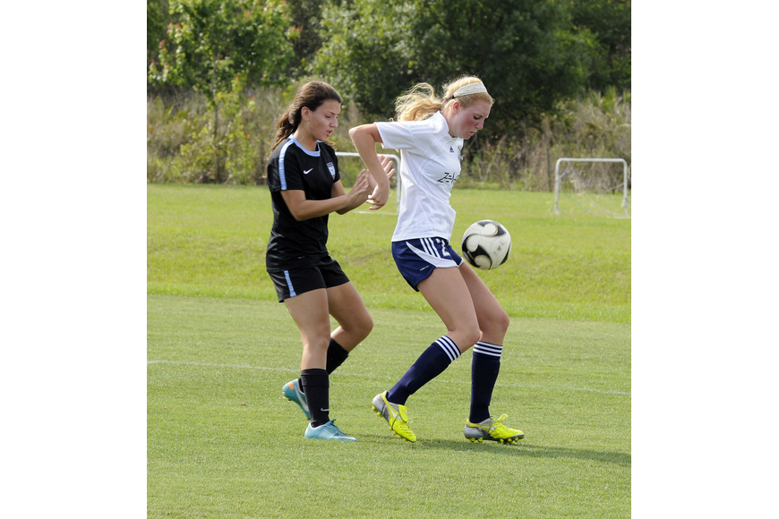 Lakewood Ranch High's Talia Falco, right, maintains possession for the VSI West Florida Flames U17 team.