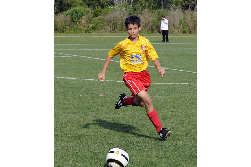Twelve-year-old Joseph Gigliotti races to the ball during the Lakewood Ranch Chargers U12 team's game against Strictly Soccer.