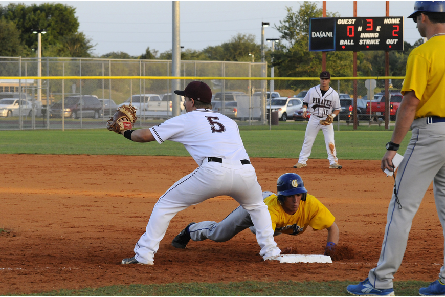 Braden River first baseman John George looks to keep a Charlotte base runner from stealing second base.