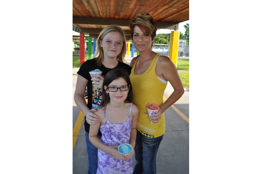 Kelley Ketron, front, enjoyed sno-cones with her sister, Libby, and mom, Sarah.