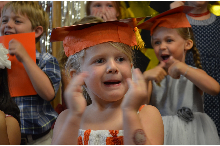 Addie Litherland sings a song with her classmates at the close of the graduation.