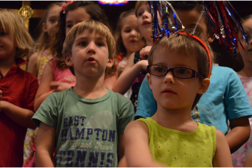 Jonathan Mauro and Isabelle Faucher wait to hear instructions on when to sing for parents.
