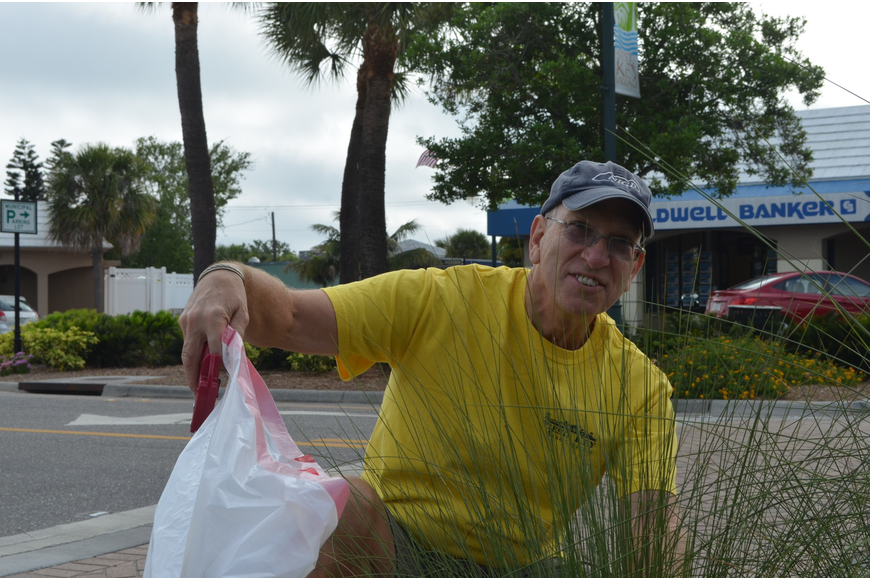 Bill Irish moved to Sarasota from the Baltimore area almost two years ago. He helped pick up trash in Siesta Key Village on Saturday morning.
