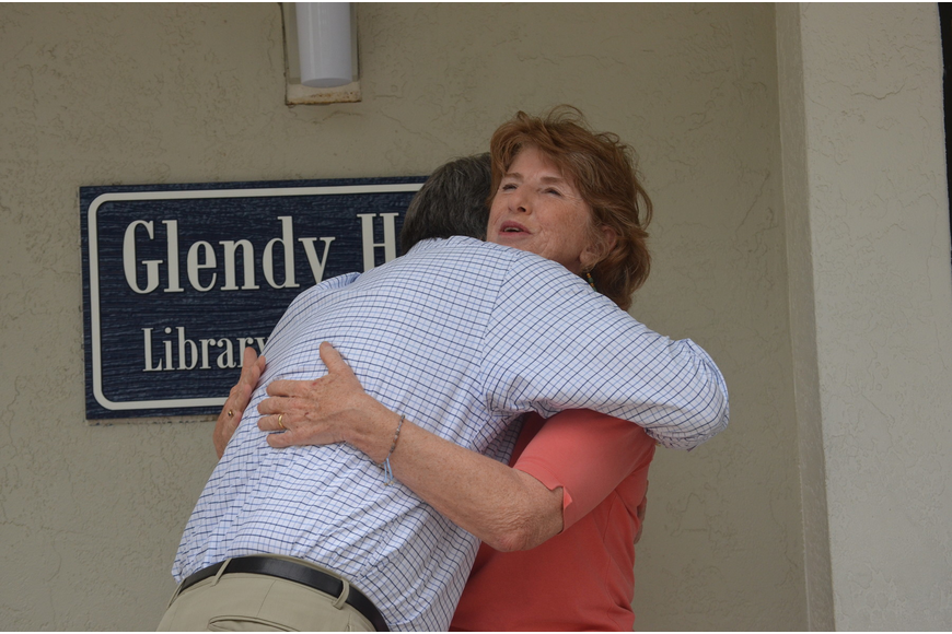 Head of School David Mahler hugs Glendy Huene and thanks her for her years of service.