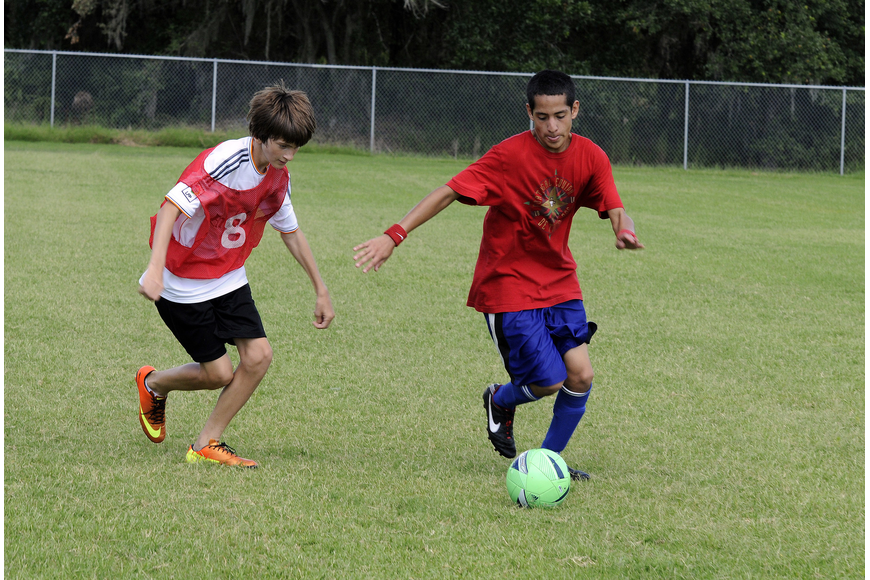 Lakewood Ranch High freshman Julian Warner, right, attempts to maneuver the ball around Haile Middle eighth-grader Justin Novak.