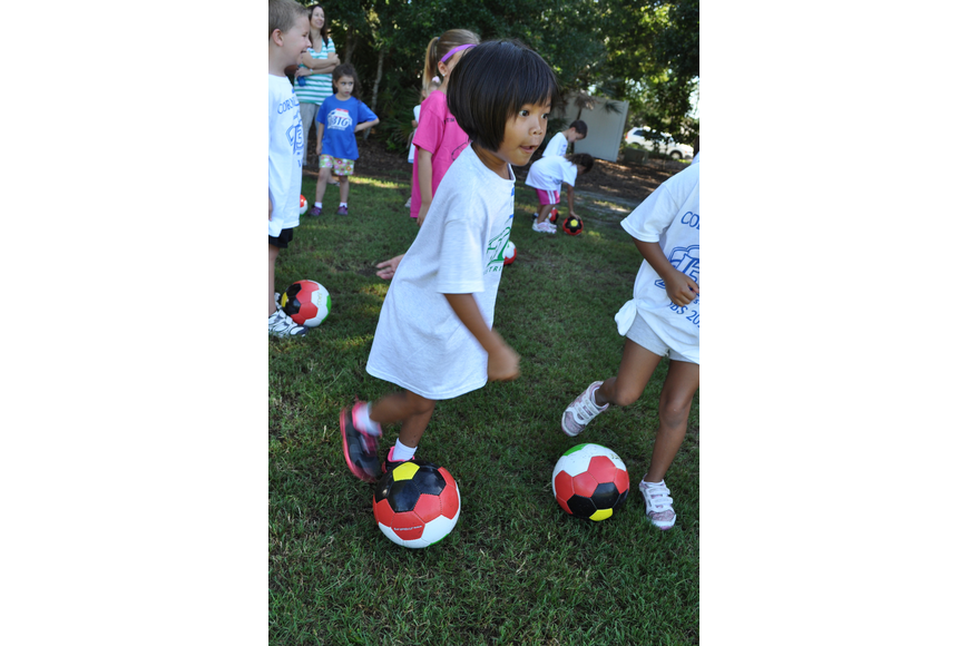Five-year-old Kara Shumway takes the field for soccer practice.