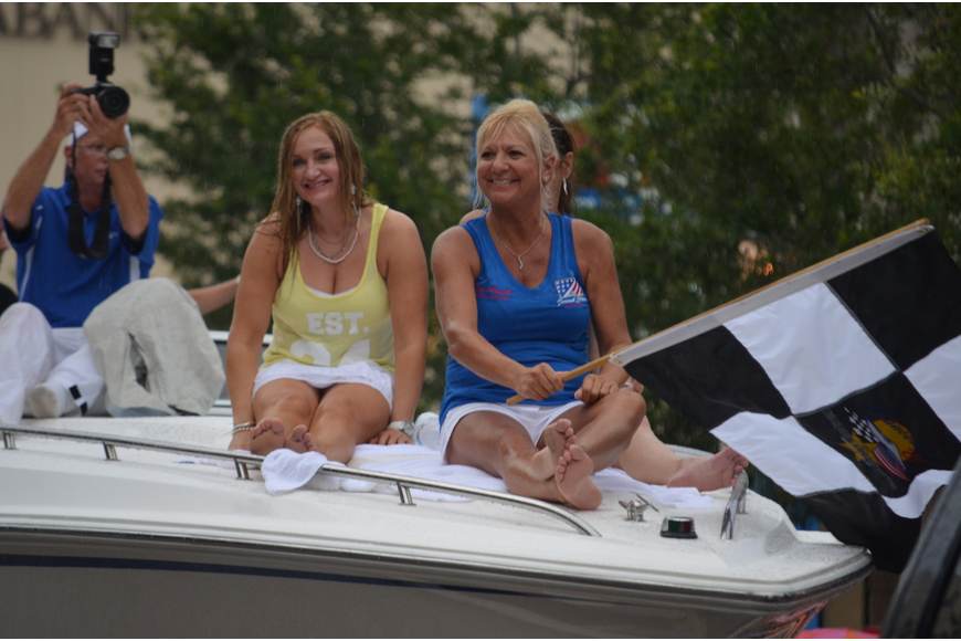 Suncoast Grand Prix Festival Organizer Lucy Nicandri and her team wave to spectators.
