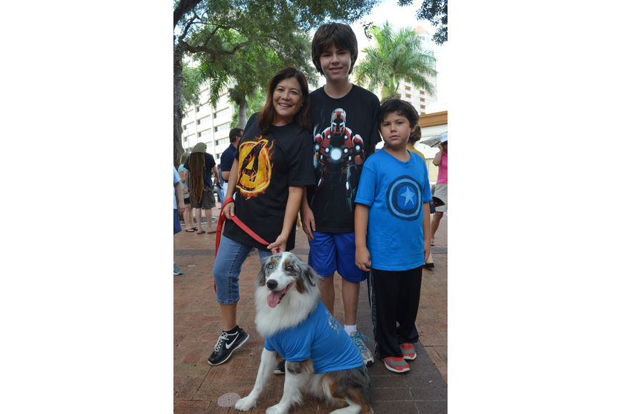 Angela Hartvigsen and her sons Ben, 12, and Will, 8, and their Australian shepherd dress as the Avengers.