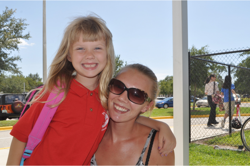 Christina Harrington picks up daughter Dominique, 6, from her first day at Phillippi Shores Elementary.