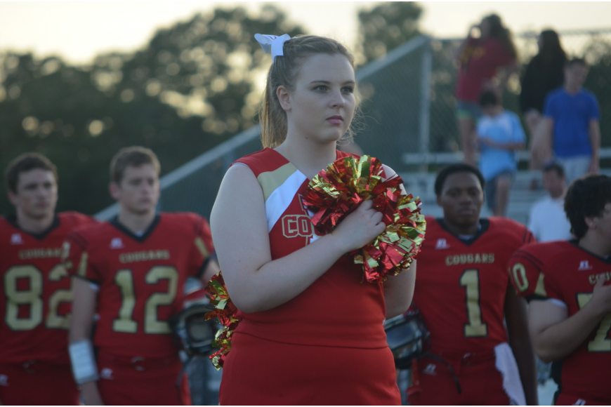 Meghan Grabowski, 16, salutes the flag during the National Anthem.